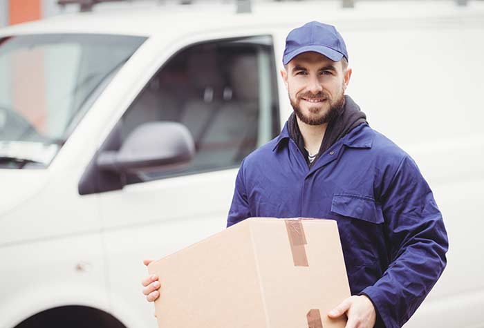 A uk same day courier holding package